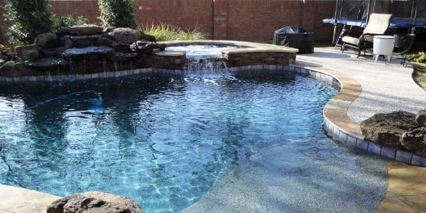 pool with spa and waterfall
