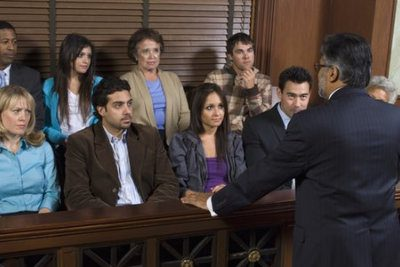 Rear view of a advocate communicating with the jurors
