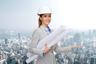 woman holding blueprints